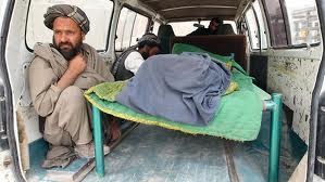 an Afghan man next to a killed relative / the daily telegraph