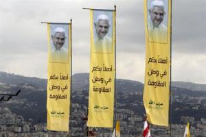 Hezbollah banners welcoming the Pope in Lebanon/Mohammad Azakin