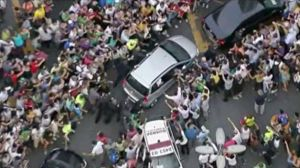 crowds willing to see the Pope surrounded his silver car.